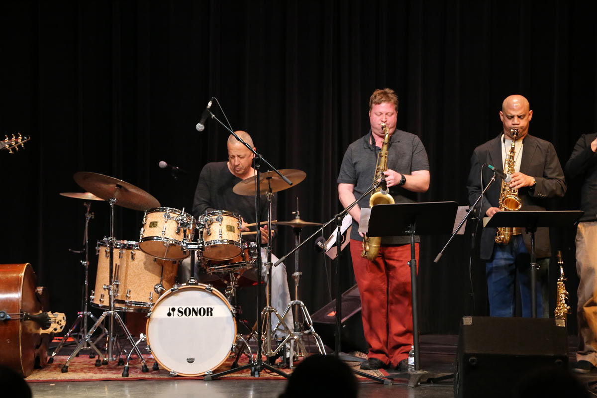 Jae Sinnett performing with members of Subject to Change in 2014