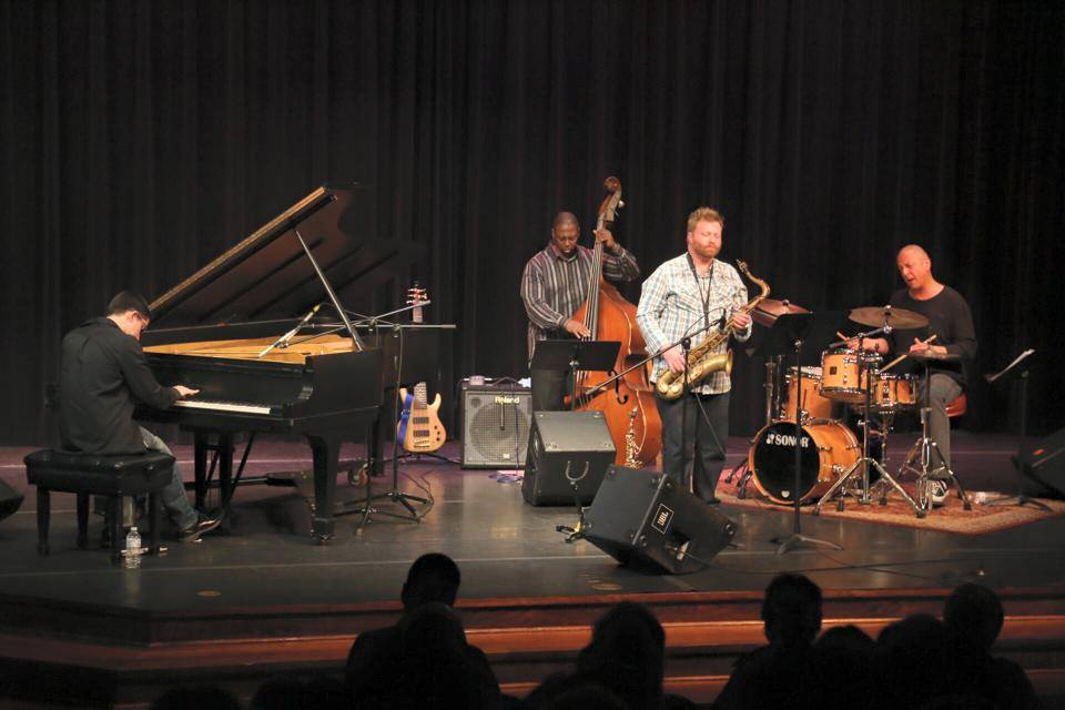 The Jae Sinnett Quartet performing at the Williamsburg Library Theater in 2015